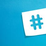 White hashtag on a blue background